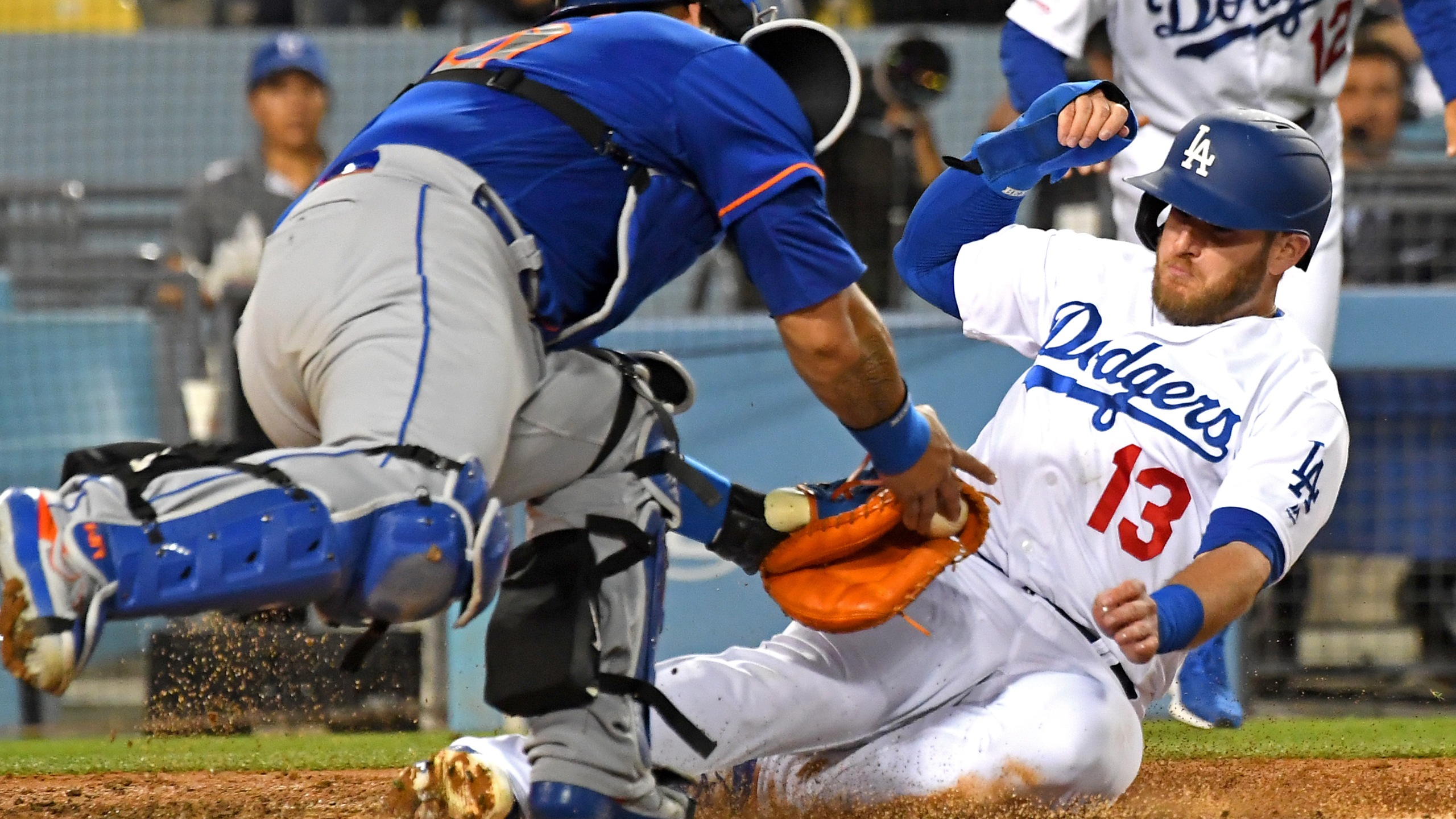 Max Muncy of the Los Angeles Dodgers is safe at home as he beats the tag by Wilson Ramos of the New York Mets, scoring on a single by Justin Turner at Dodger Stadium on May 29, 2019. (Credit: Jayne Kamin-Oncea / Getty Images)