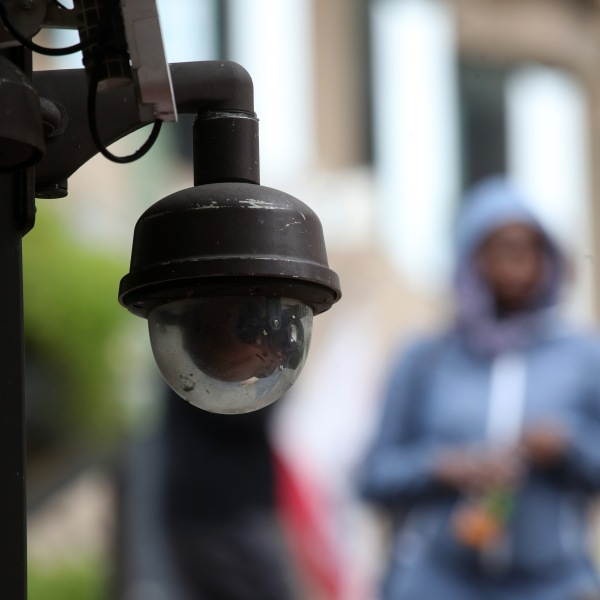 A video surveillance camera hangs from the side of a building in San Francisco on May 14, 2019. (Credit: Justin Sullivan / Getty Images)