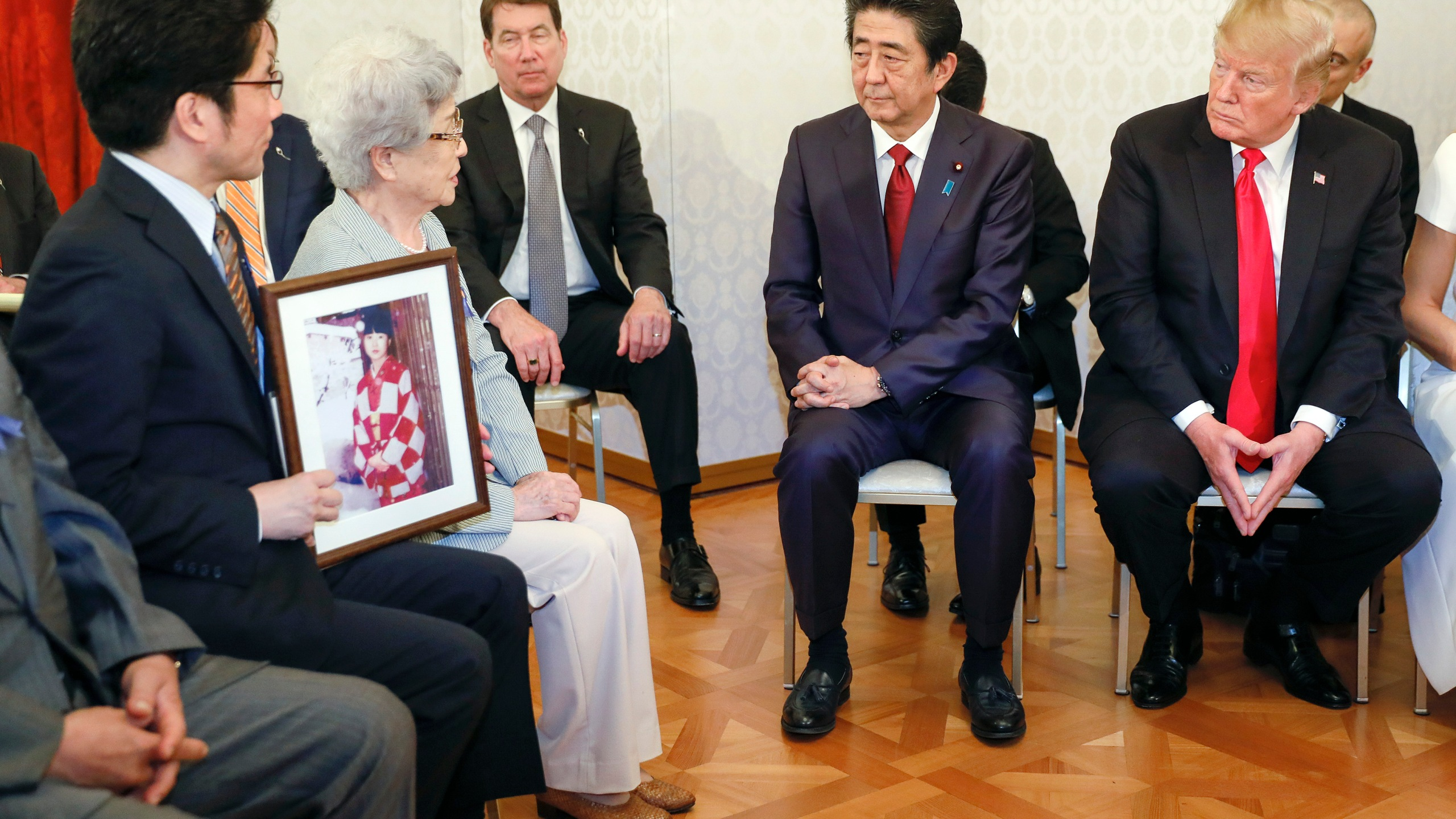 U.S. President Donald Trump listens to Sakie Yokota, mother of Megumi Yokota, who was kidnapped by North Korean agents at the age of 13 in 1977, as he meets the families of Japanese abductees by North Korea with Japanese Prime Minister Shinzo Abe (2-R) at Akasaka State Guesthouse on May 27, 2019, in Tokyo, Japan. (Credit: Kimimasa Mayama - Pool/Getty Images)
