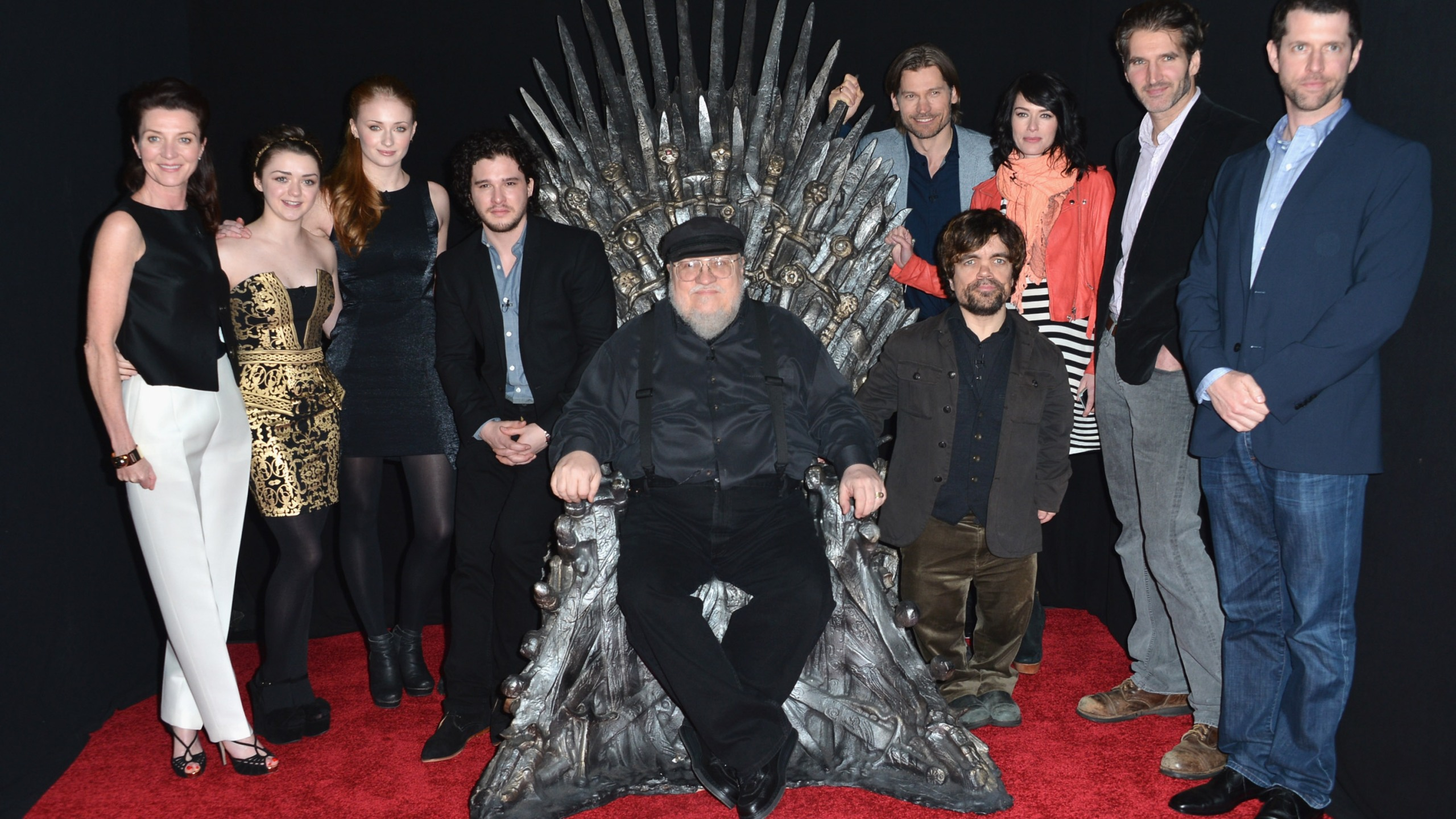"Actors Michelle Fairley, Maisie Williams, Sophie Turner, Kit Harington, executive producer George R.R. Martin, actors Nikolaj Coster-Waldau, Peter Dinklage, Lena Headey, co-creator/executive producer David Banioff and co-creator/executive producer D.B. Weiss attend The Academy of Television Arts & Sciences' Presents An Evening With ""Game of Thrones"" at TCL Chinese Theatre on March 19, 2013. (Credit: Alberto E. Rodriguez/Getty Images)"
