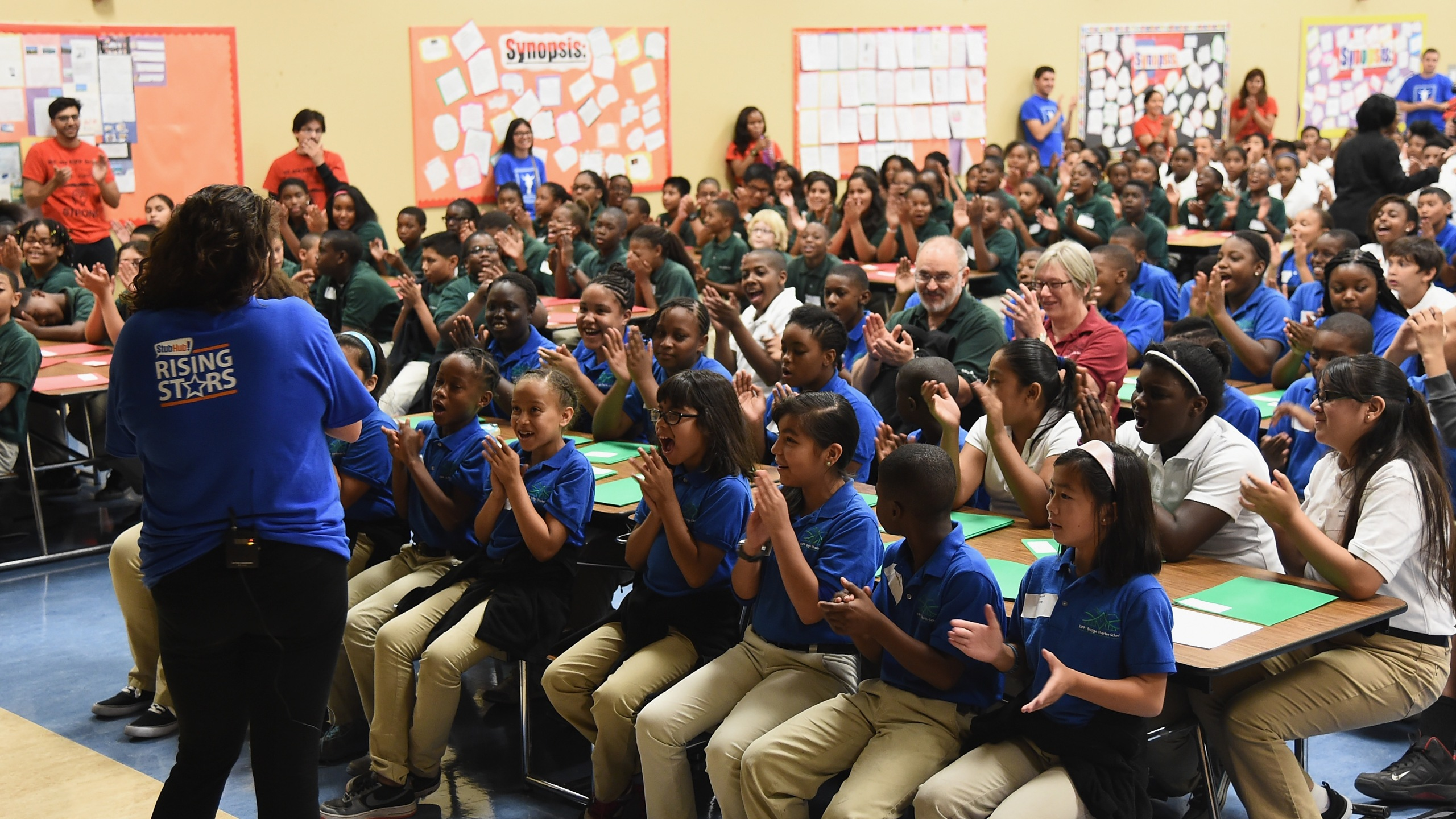 Music teacher Elizabeth Berliant talks with students as StubHub and Mr. Holland's Opus Surprise Bay Area Students with new instruments at KIPP Bridge Charter School on Aug. 12, 2014, in San Francisco. (Credit: Michael Buckner/Getty Images for StubHub)