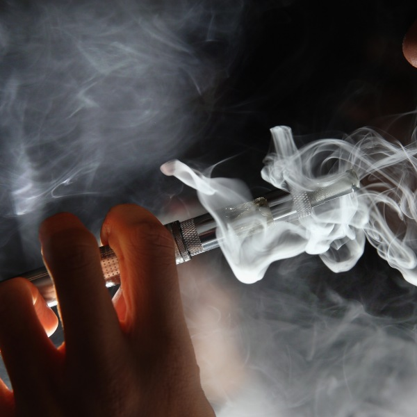 In this photo illustration, a man smokes an e-cigarette at a shop in London on Aug. 27, 2014. (Credit: Dan Kitwood / Getty Images)