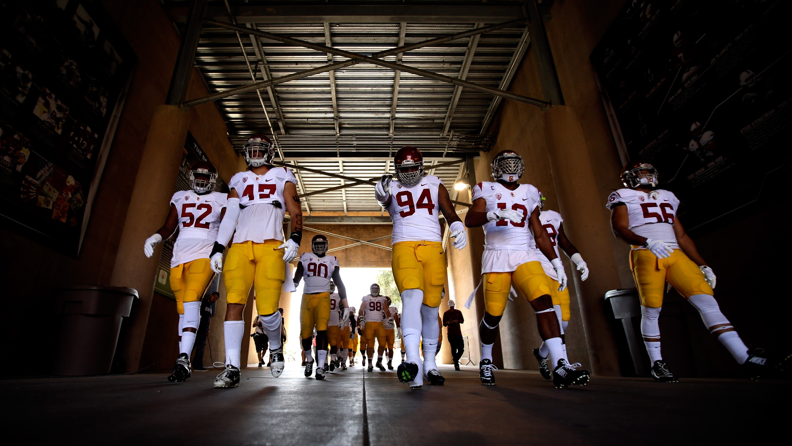 USC Trojans football players walk down the tunnel ahead of a game against the Stanford Cardinal in Palo Alto on Sept. 6, 2014. (Credit: Ezra Shaw / Getty Images)