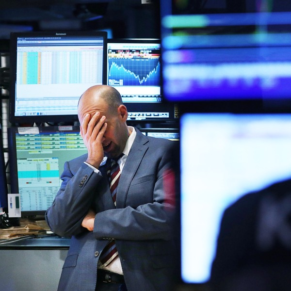 A trader works on the floor of the New York Stock Exchange (NYSE) on October 15, 2014 in New York City. (Credit: Spencer Platt/Getty Images)
