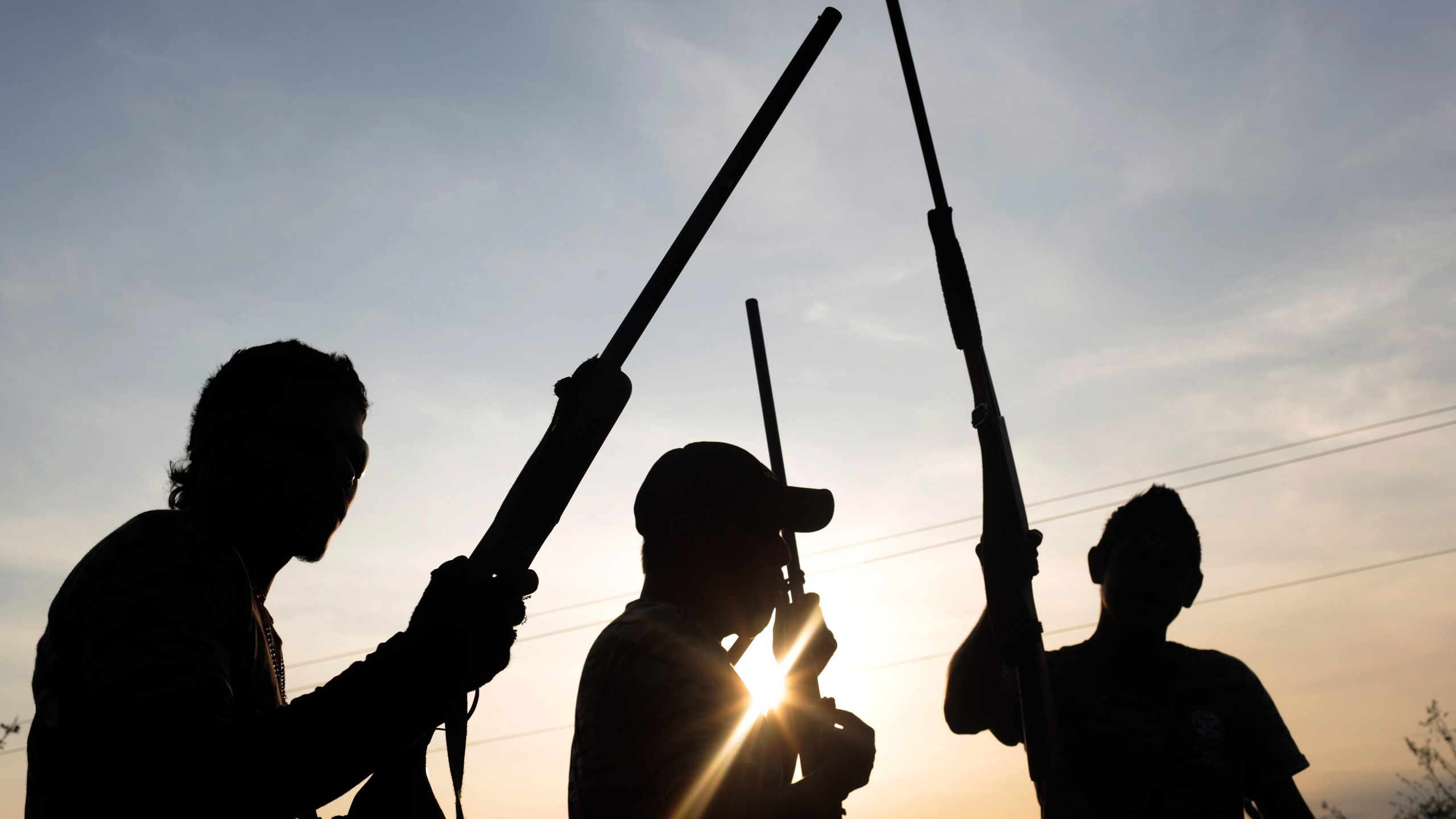 Members of the vigilante group United Front for Security and Development of the State of Guerrero (FUSDEG) take positions after learning of an alleged imminent attack by the rival group Union of Villages and Organizations of the State of Guerrero (UPOEG) at San Juan del Reparo, Guerrero State, Mexico on March 31, 2015. (Credit: Pedro PARDO/AFP/Getty Images)