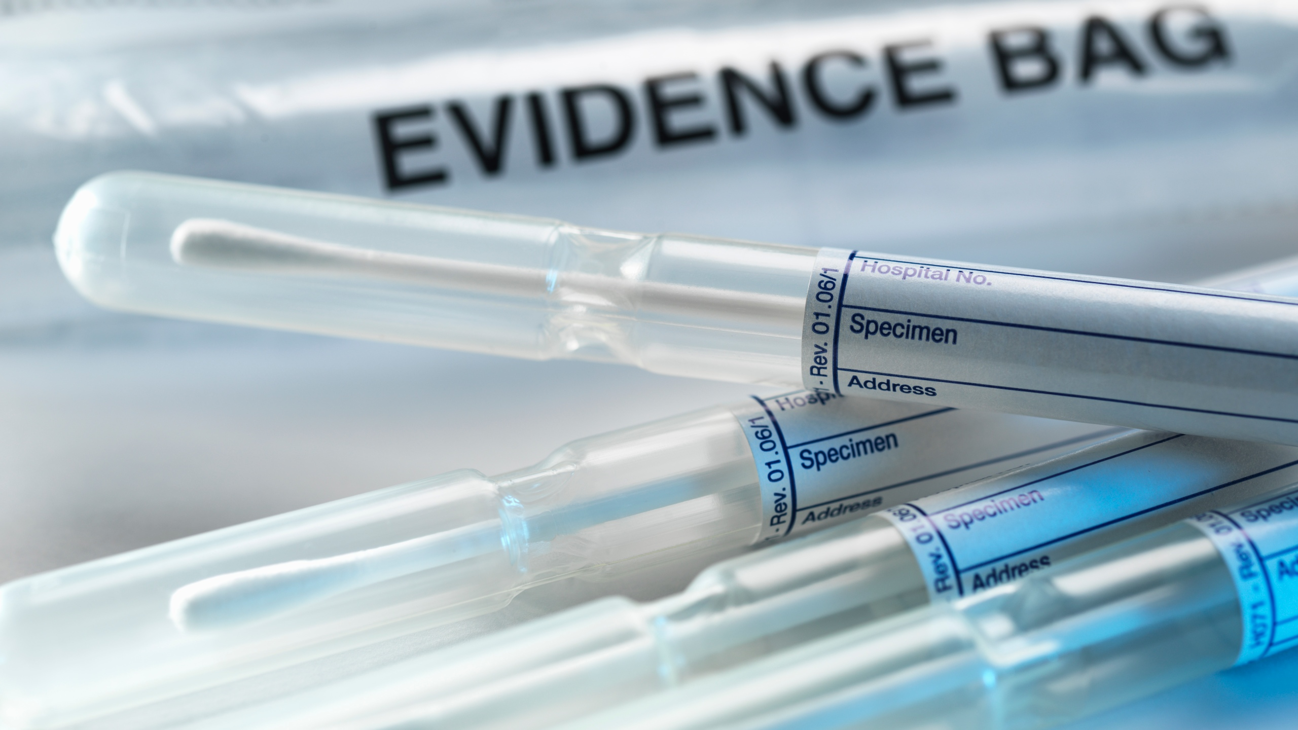 A row of samples from a crime scene on top of genetic testing results are pictured in this undated photo. (Credit: Getty Images)