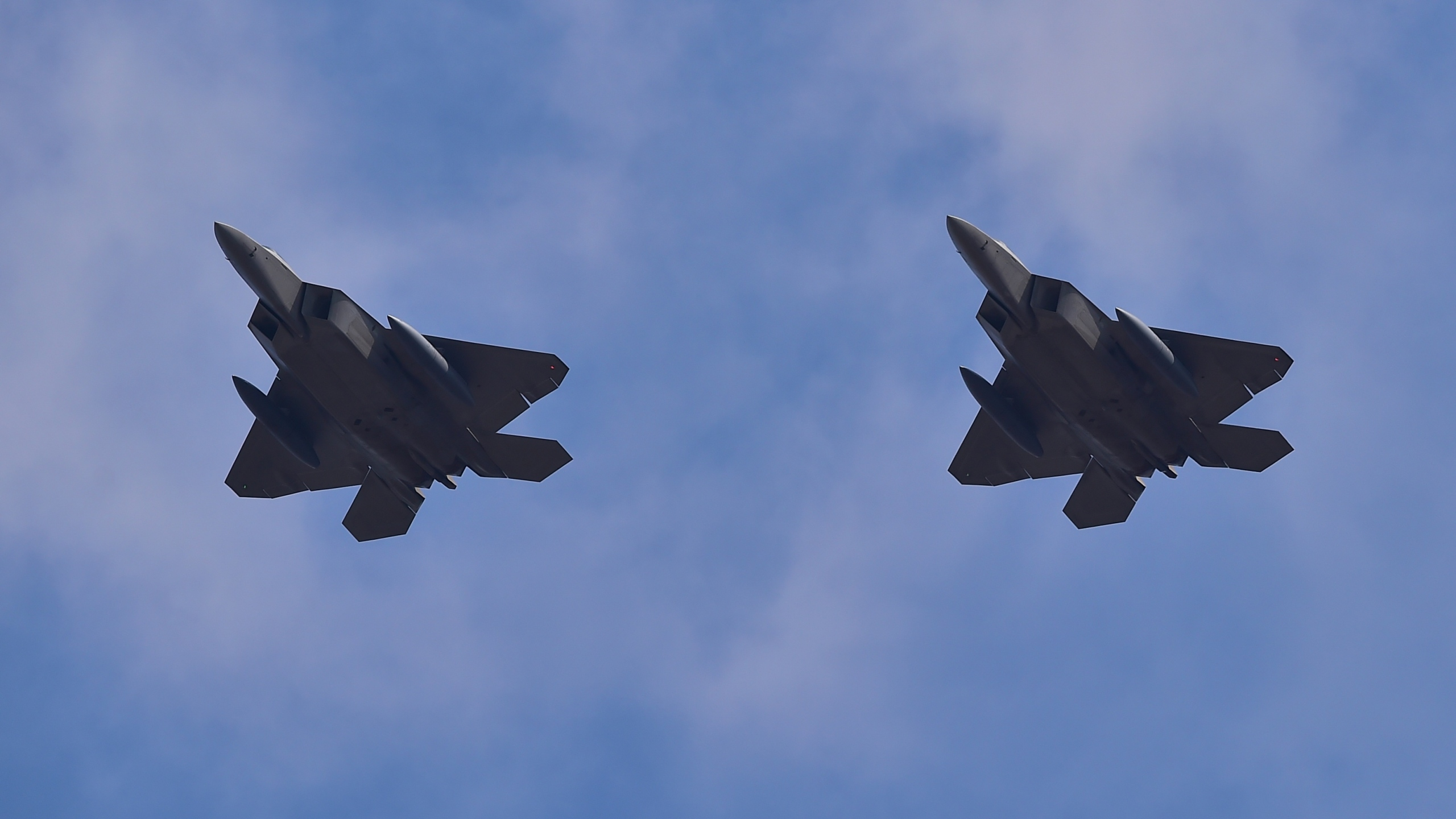 US F-22 stealth fighters fly over Osan Air Base in Pyeongtaek, south of Seoul, on February 17, 2016. (Credit: JUNG YEON-JE/AFP/Getty Images)