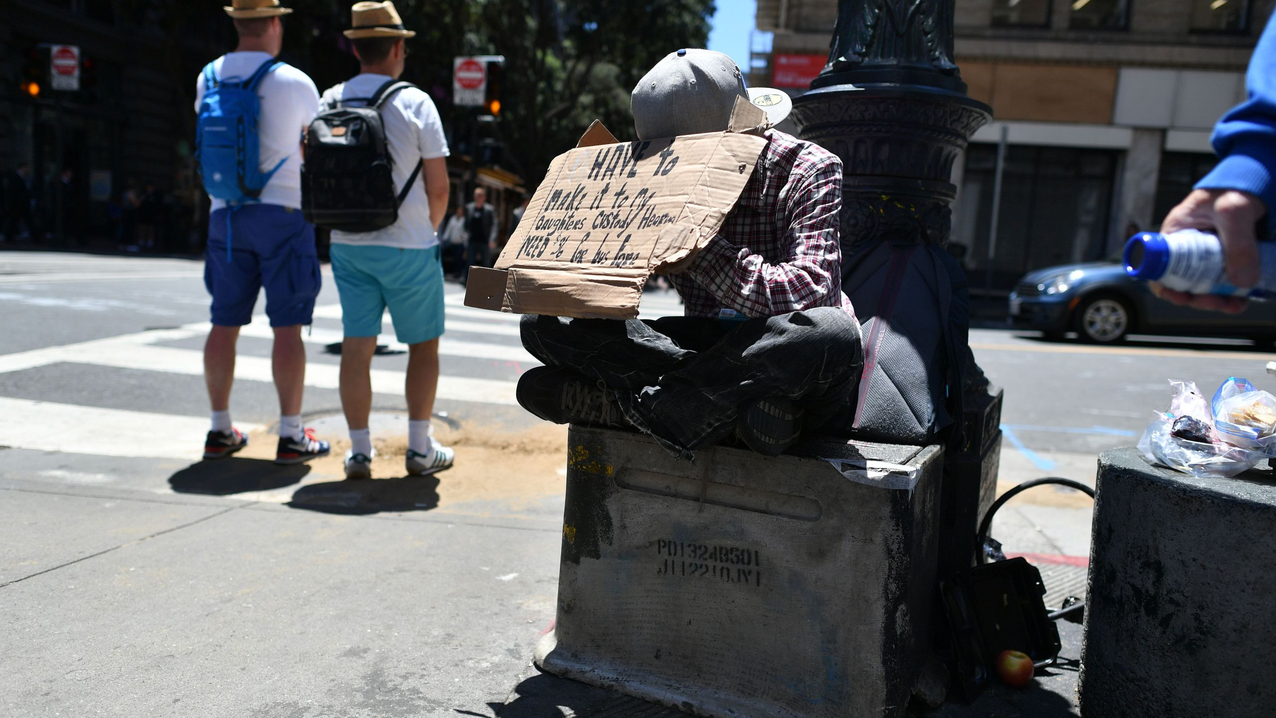 A homeless man begs along a sidewalk in downtown San Francisco, California on June, 28, 2016. (Credit: JOSH EDELSON/AFP/Getty Images)