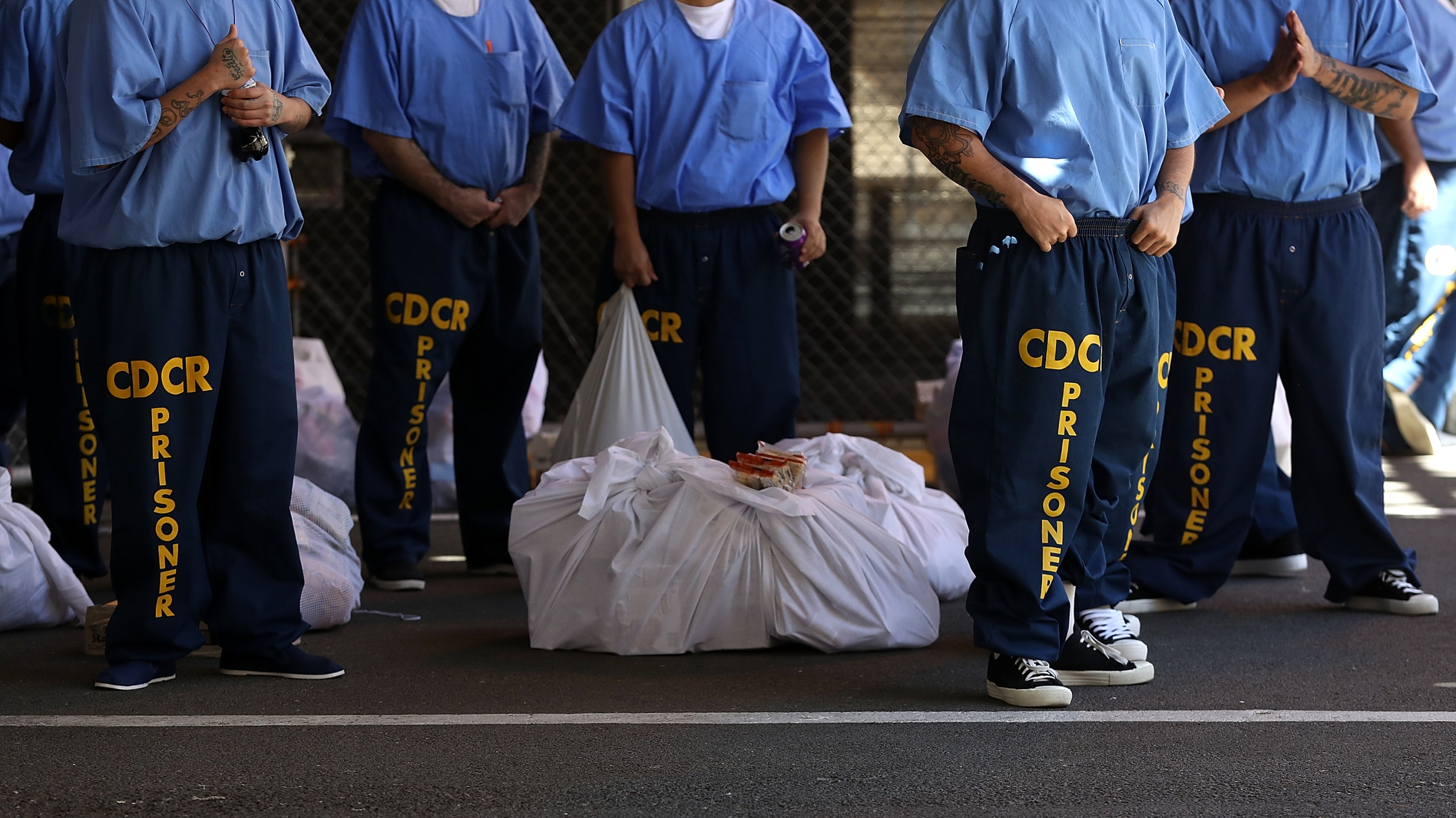 Inmates at San Quentin State Prison wait in line on Aug. 15, 2016. (Justin Sullivan / Getty Images)