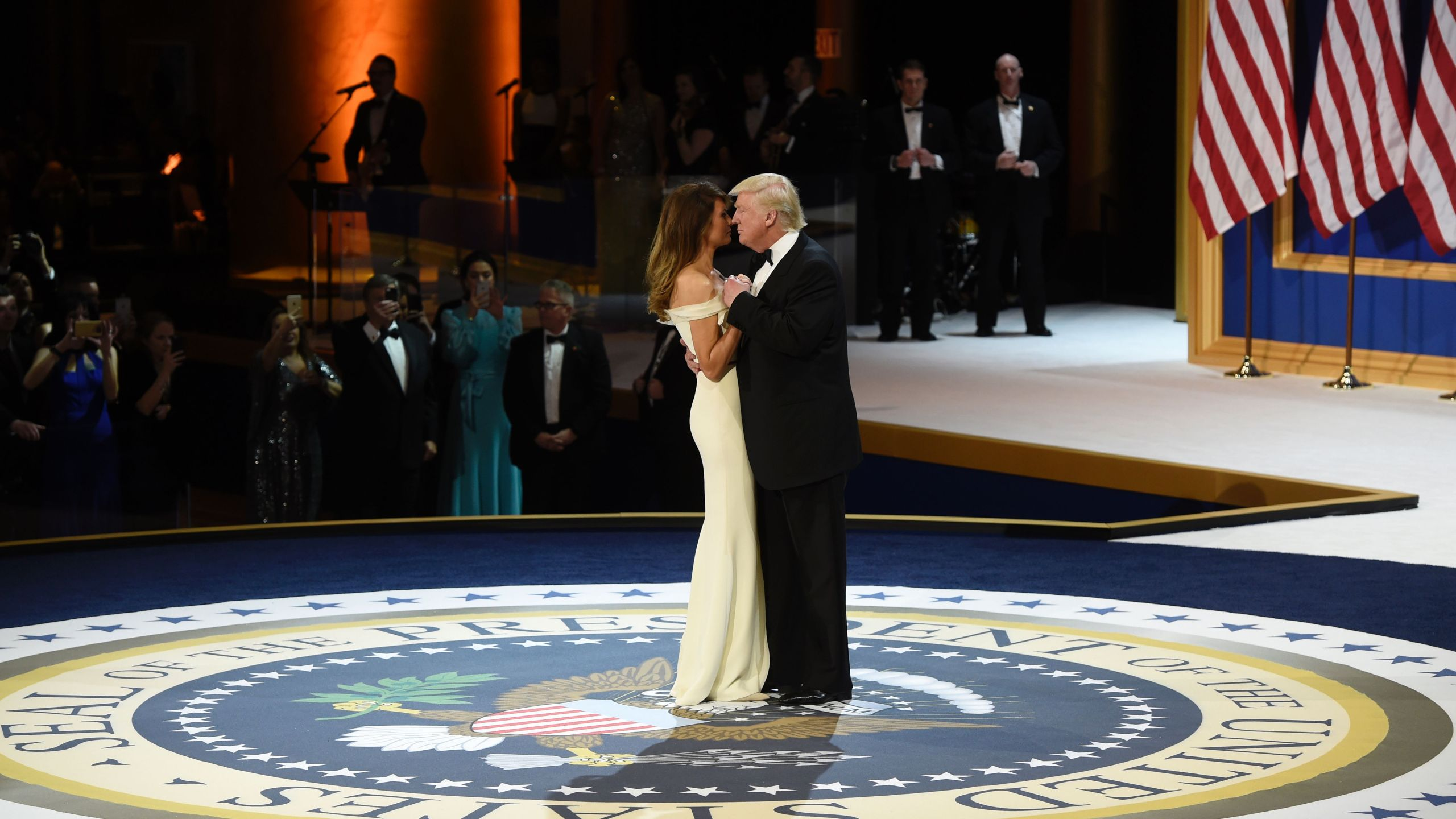 Donald Trump and First Lady Melania Trump dance on the U.S. President seal during the Salute to Our Armed Services Inaugural Ball at the National Building Museum in Washington, D.C., on Jan. 20, 2017. (Credit: Saul Loeb/AFP/Getty Images)