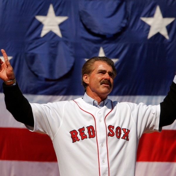 Former Boston Red Sox player Bill Buckner acknowledges the cheers from the crowd before throwing out the ceremonial first pitch at the MLB baseball game between the Boston Red Sox and Detroit Tigers on April 8, 2008 at Fenway Park in Boston, Massachusetts. (Credit: Brian Snyder-Pool/Getty Images)