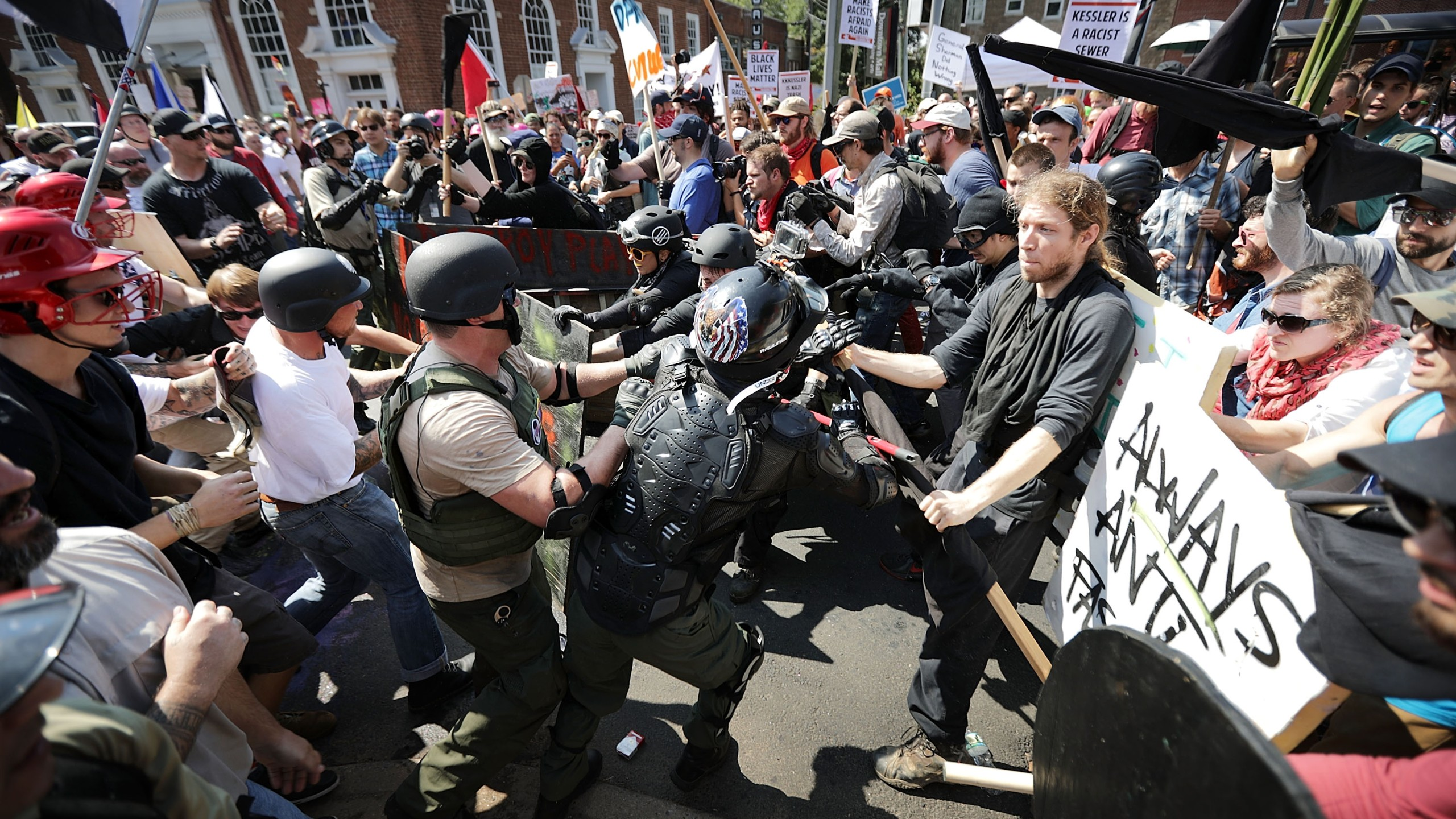 "White nationalists, neo-Nazis and members of the ""alt-right"" clash with counter-protesters as they enter Emancipation Park during the ""Unite the Right"" rally August 12, 2017 in Charlottesville, Virginia."