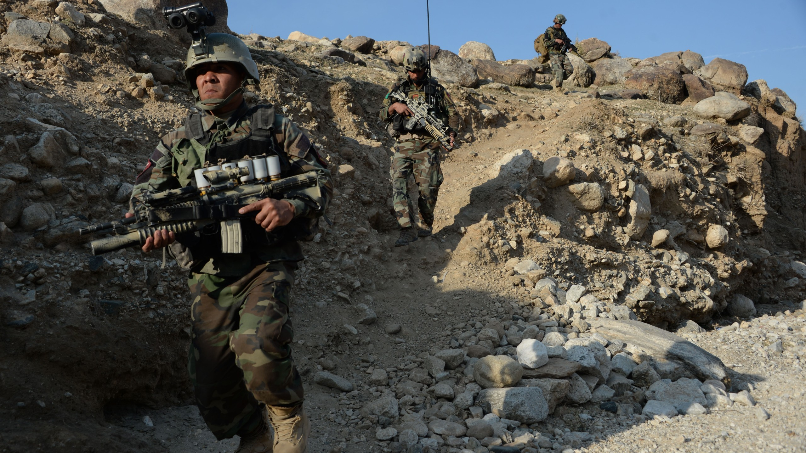 In this photograph taken on January 3, 2018, Afghan commandos forces patrol during ongoing U.S.-Afghan military operation against Islamic State militants in Achin district of Nangarhar province. (Credit: NOORULLAH SHIRZADA/AFP/Getty Images)