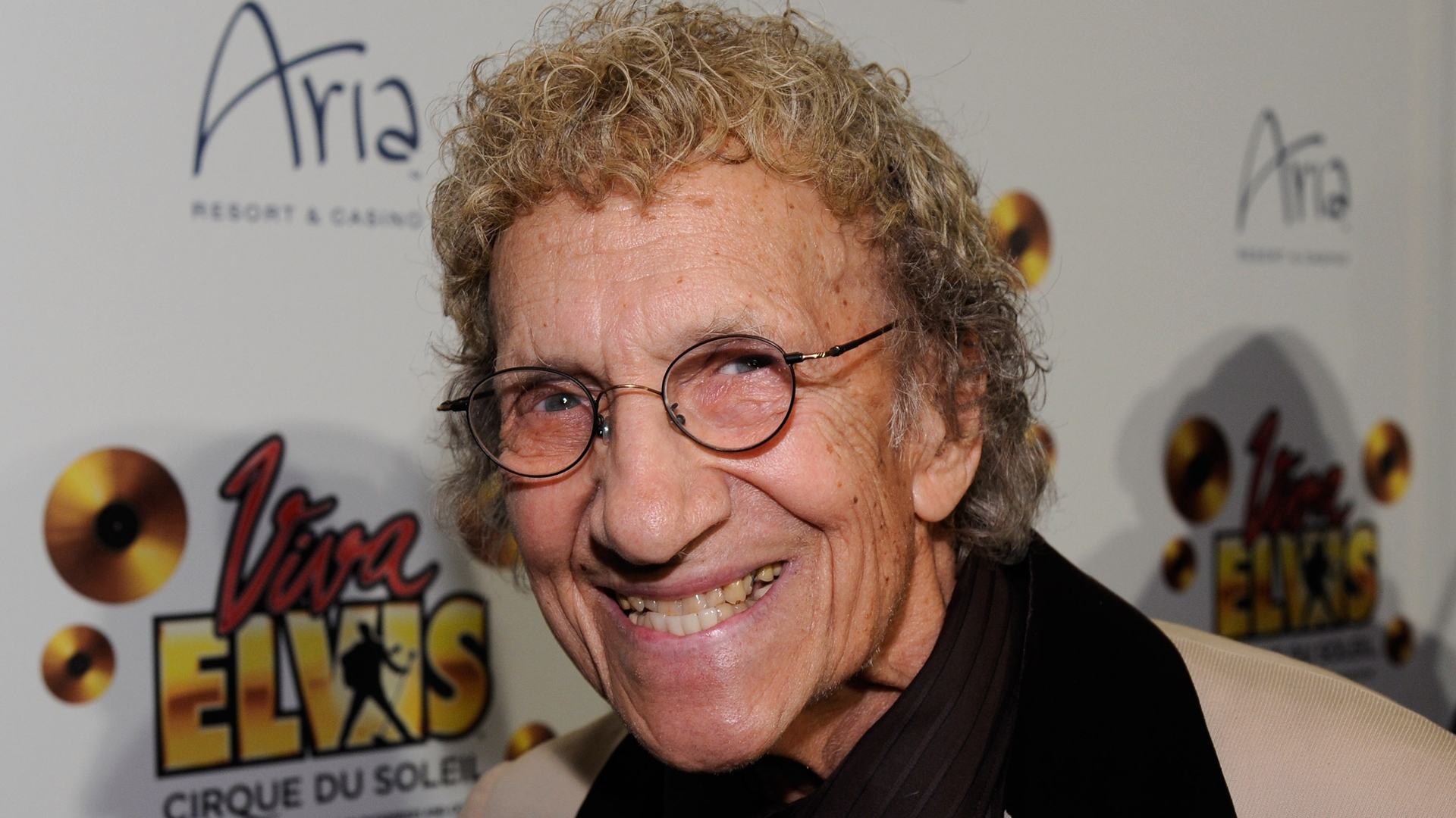 """Comedian Sammy Shore arrives at the world premiere of Cirque du Soleil's """"Viva ELVIS"""" production at the Aria Resort & Casino on Feb. 19, 2010, in Las Vegas, Nevada. (Credit: Ethan Miller/Getty Images for Cirque du Soleil)"""