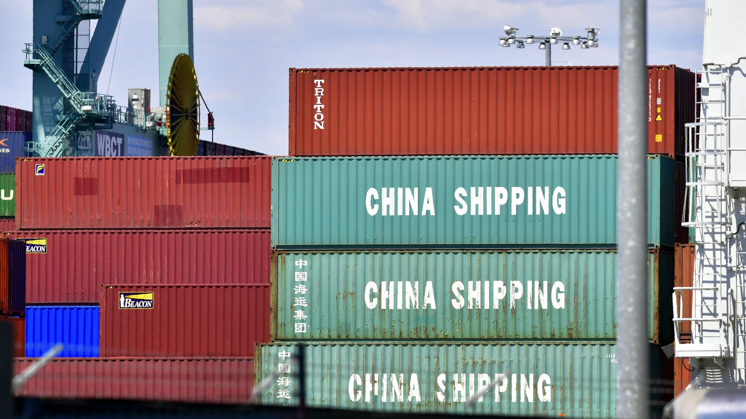 Containers are stacked on a vessel at the Port of Long Beach on July 6, 2018, including some from China Shipping, a conglomerate under the direct administration of China's State Council. (Credit: FREDERIC J. BROWN/AFP/Getty Images)