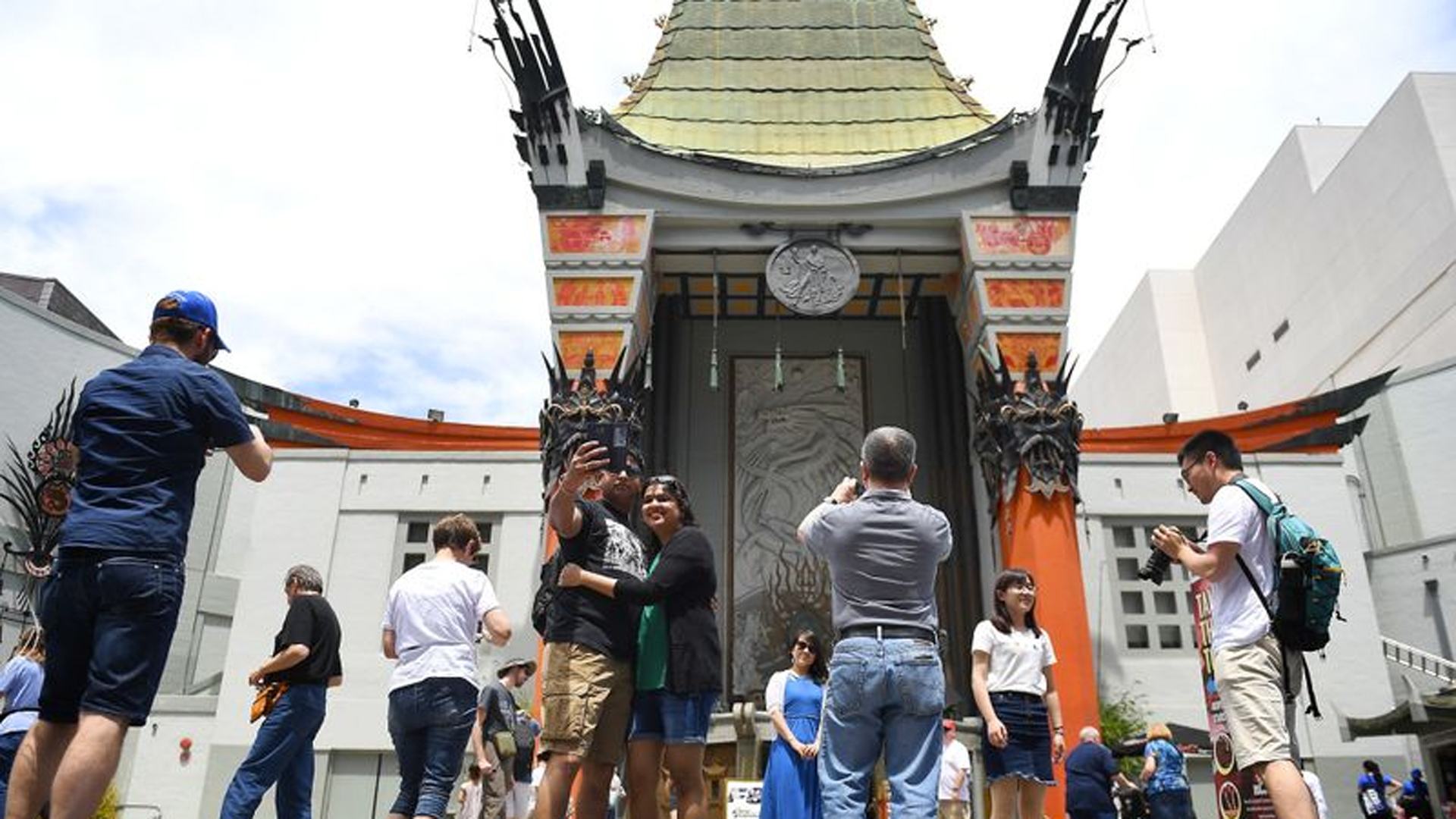 Tourists visit the TCL Chinese Theatre IMAX in Hollywood. (Credit: Christina House / Los Angeles Times)
