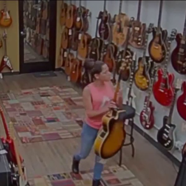 A suspect is seen during a theft at a vintage guitar store in surveillance footage obtained by KTLA.