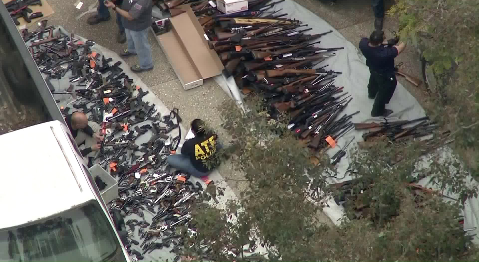 ATF officials investigate after dozens of guns are found in a Bel-Air home on May 8, 2019. (Credit: KTLA)