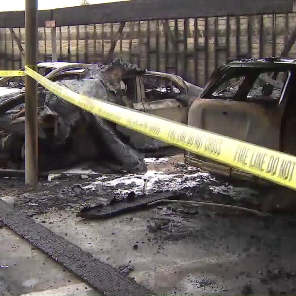A fire burned several vehicles at a carport in a residential area in Highland Park on May 26, 2019. (Credit: KTLA)