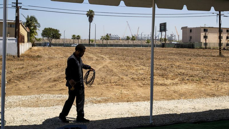 An undated photo shows the site of the proposed Clippers arena in Inglewood, with the NFL stadium in the background. (Credit: Allen J. Schaben / Los Angeles Times)
