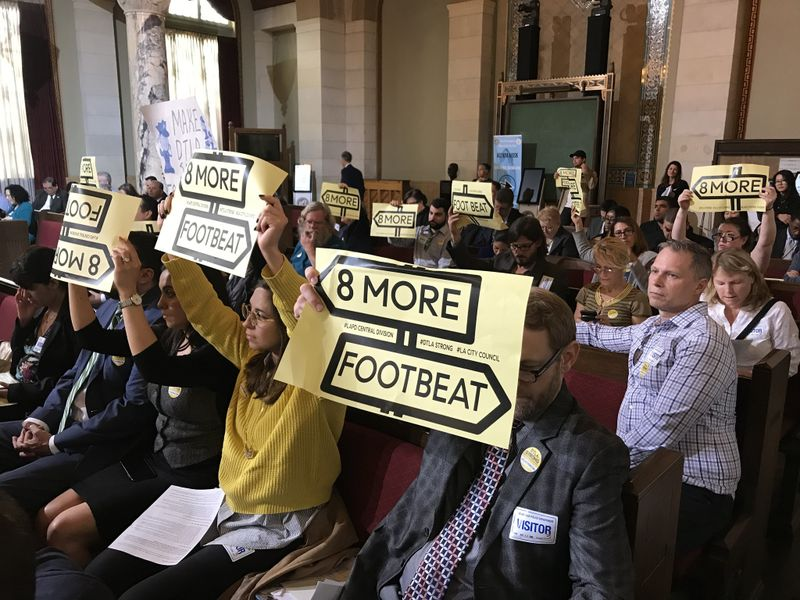 More than 50 people, most of them affiliated with the group DTLA Strong, appeared at City Hall on May 2, 2019, to demand that city leaders assign more foot patrols in downtown Los Angeles. (Credit: David Zahniser / Los Angeles Times)