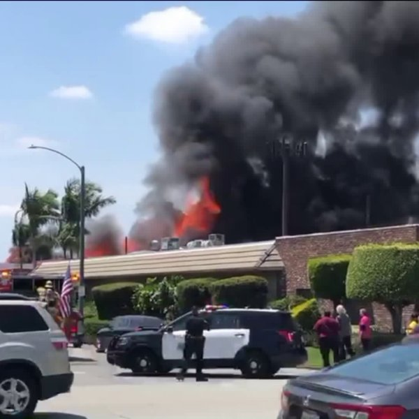"A man suffered serious burns and firefighters discovered what they described as ""drug processing equipment and chemicals"" inside a warehouse in Long Beach on May 25, 2019. (Credit: Loudlabs)"