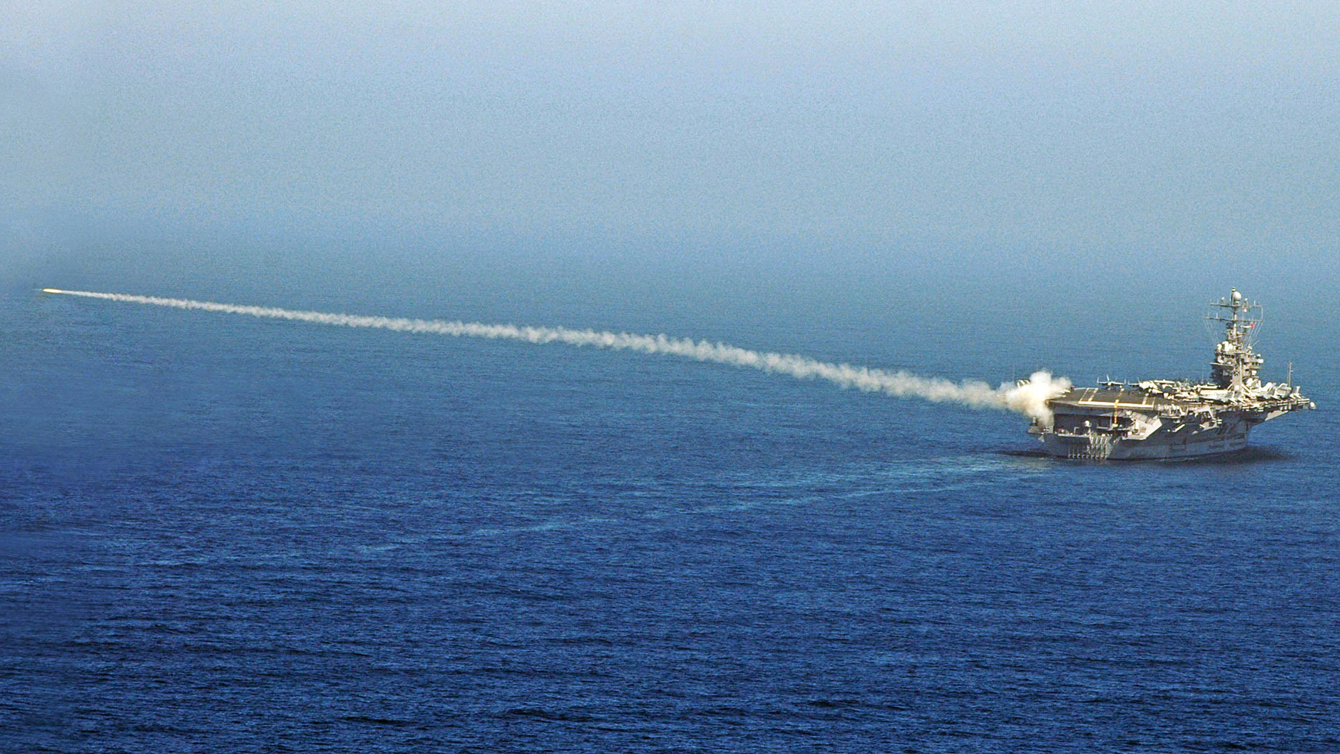In this handout photo provided by the U.S. Navy, a RIM-7P NATO Sea Sparrow Missile launches from Nimitz-class aircraft carrier USS Abraham Lincoln (CVN 72) during a stream raid shoot exercise on August 13, 2007 At Sea. (Credit: M. Jeremie Yoder/U.S. Navy/Getty Images)
