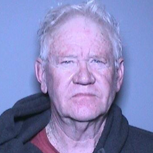 John Rodgers McFarland is seen in a booking photo released by the Orange County District Attorney's Office.