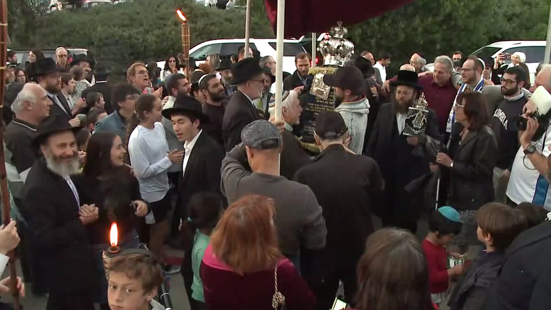 The Chabad of Poway community gathers at the synagogue on May 22, 2019, to honor Lori Kaye, who was killed in a shooting attack there the month before. (Credit: KSWB)