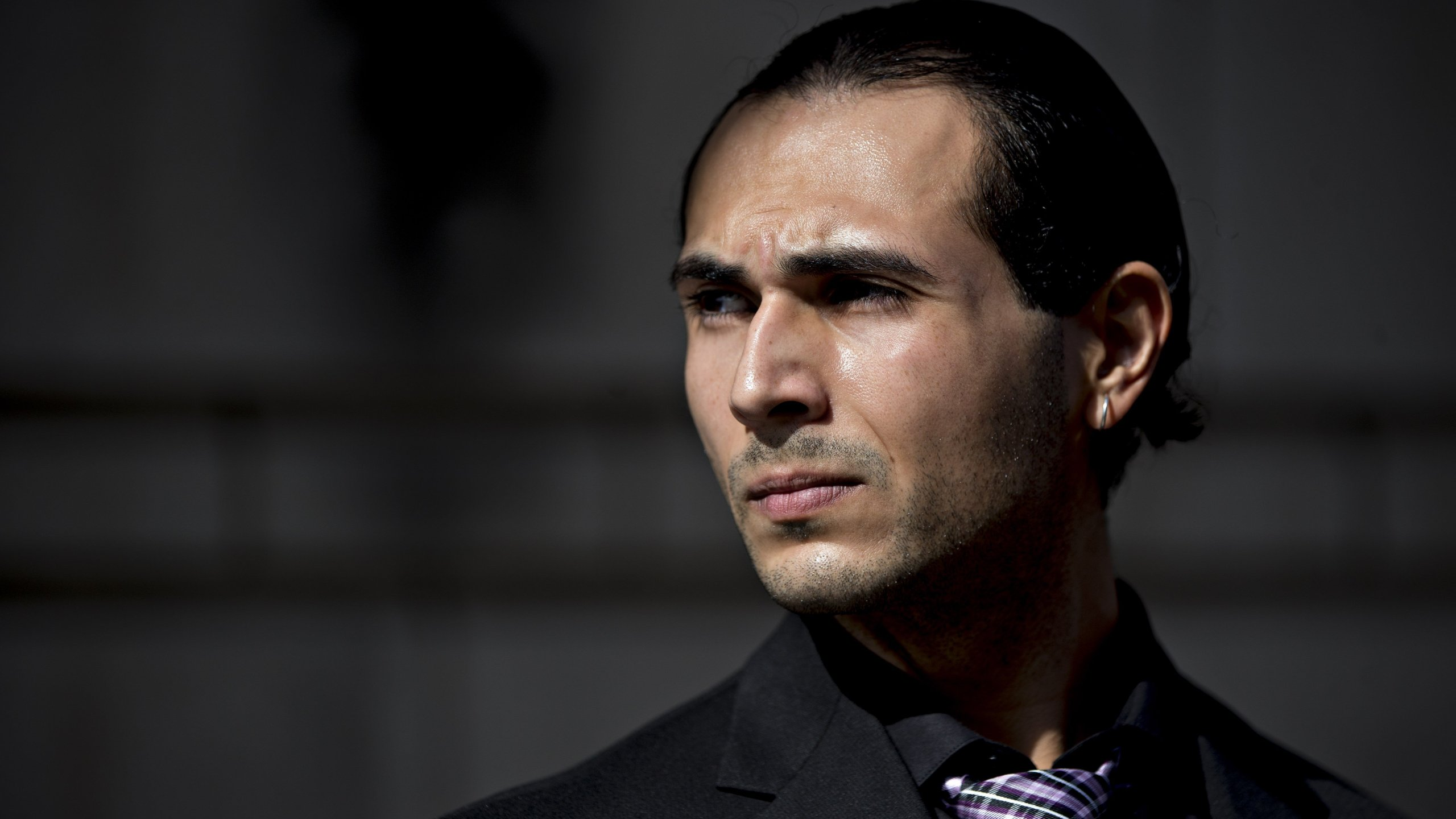Richard Pinedo of Santa Paula, California, listens as his lawyer speaks to members of the media outside federal court after sentencing in Washington, D.C. (Credit: Andrew Harrer/Bloomberg/Getty Images)