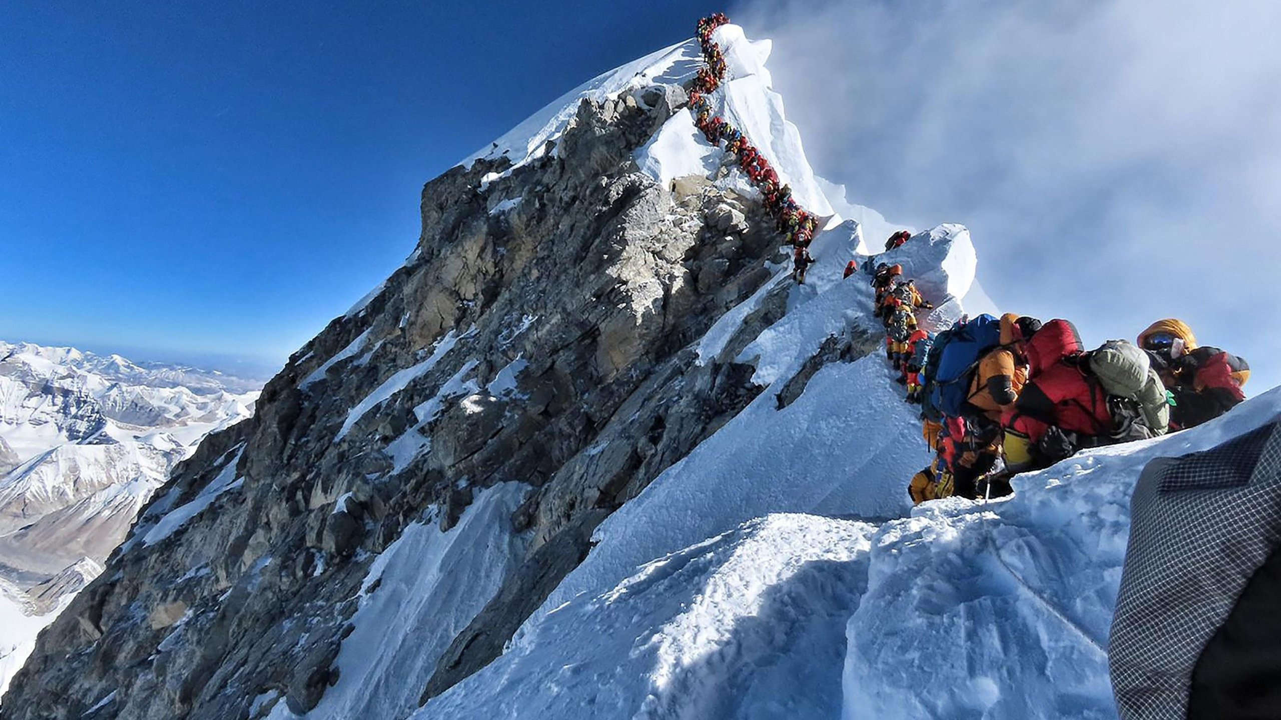 Climbers wait to reach the summit of Everest in this image taken May 22. (Credit: Project Possible/Getty Images via CNN)