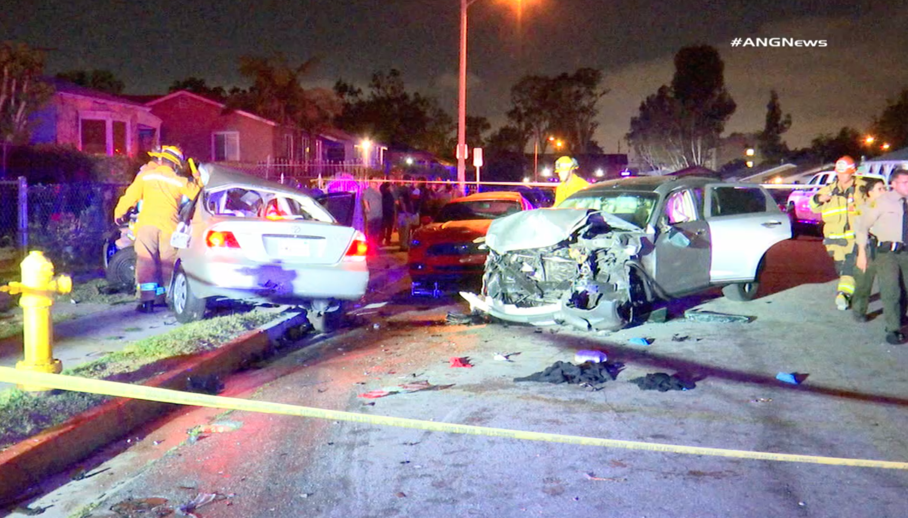 Officers assess two mangled vehicles that had collided in Willowbrook on May 11, 2019. (Credit: ANG News)