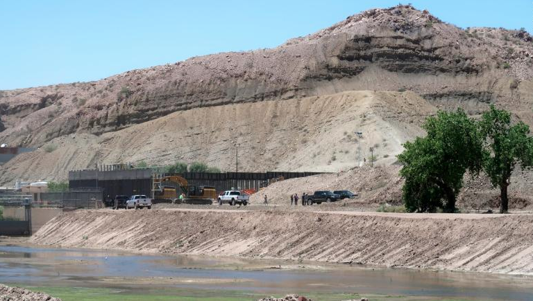 Construction crews are seen working in an area of the U.S.-Mexico border near the New Mexico-Texas state line, in an image taken from CNN video.