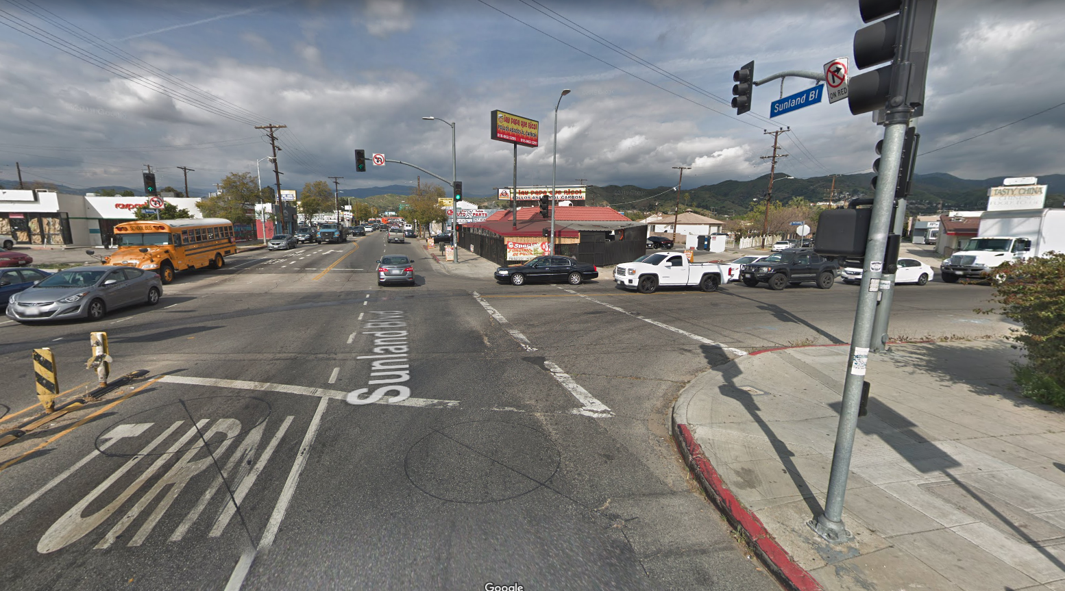 A Google Maps image shows an intersection near Sunland Boulevard in Sun Valley.