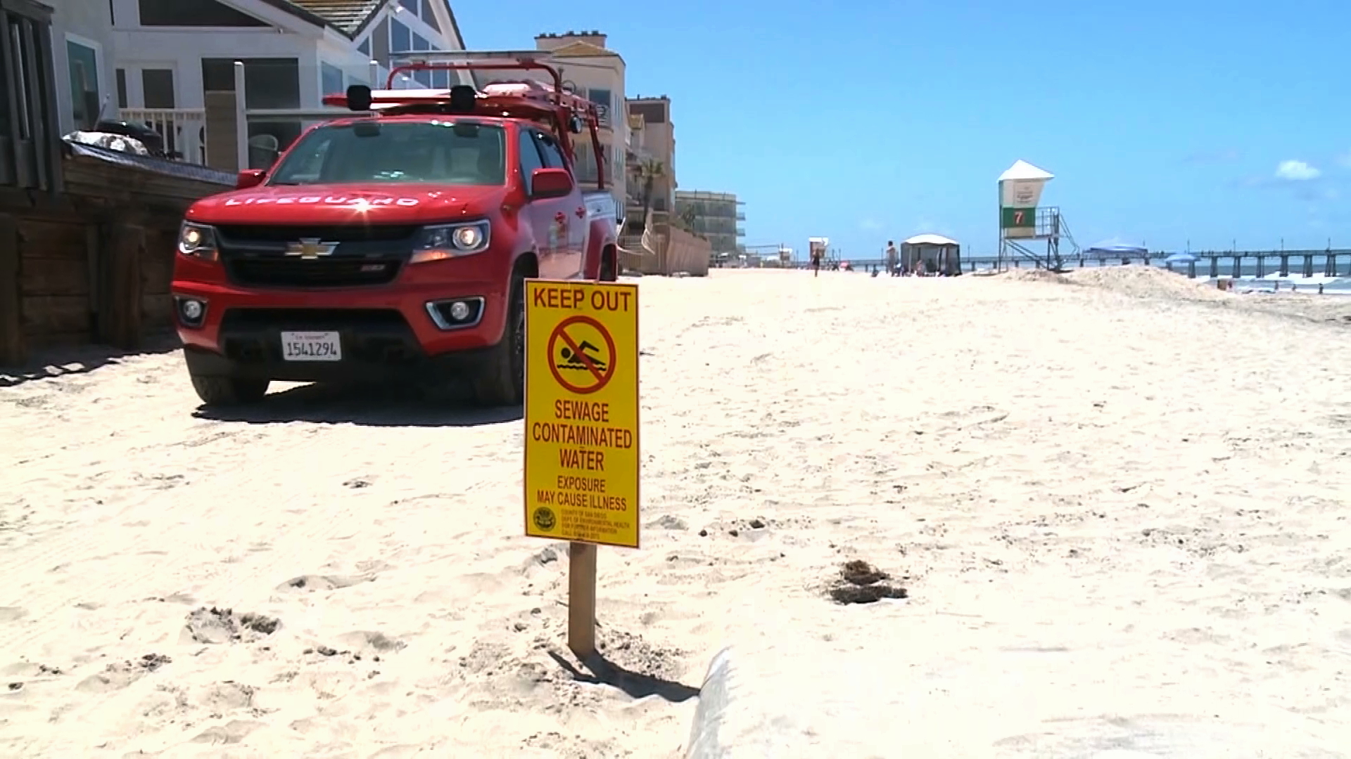 A sign warning beachgoers to keep out of the water at Imperial Beach is posted on May 27, 2019, after contaminated runoff flowed into the area from Mexico's Tijuana River. (Credit: KSWB via CNN)