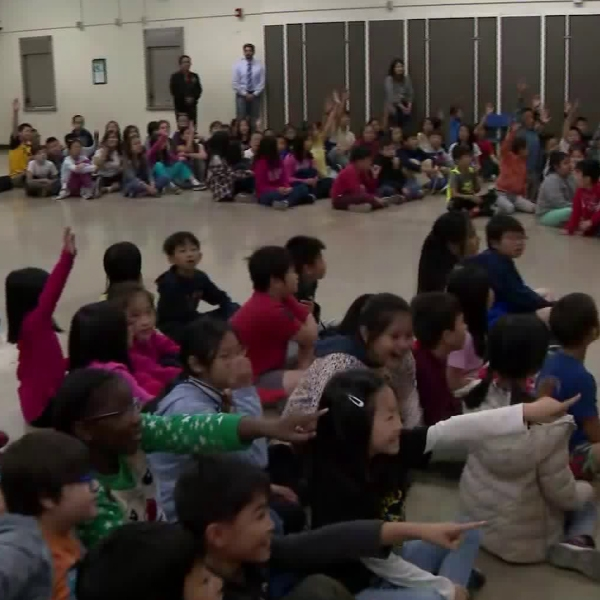 Students at Castelar Elementary School in downtown Los Angeles' Chinatown neighborhood were surprised with musical instruments on May 21, 2019. (Credit: KTLA)