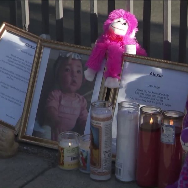 A memorial for 8-month-old Alexia Rose Echeverria is seen near the Bellflower mortuary where her body was found. (Credit: KTLA)