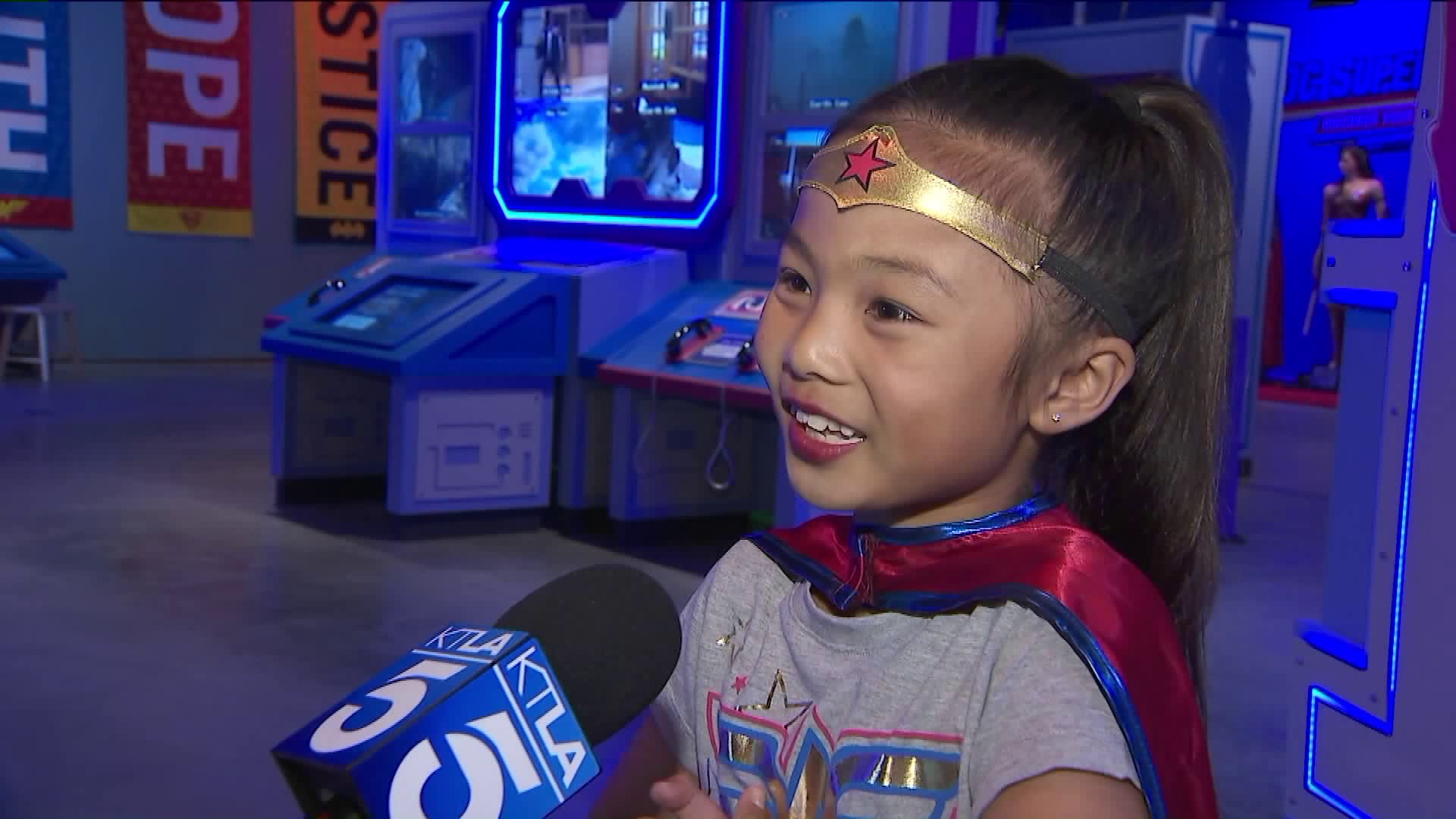 "A child speaks to KTLA at the ""Discover Your Superpowers"" exhibit at Discovery Cube Orange County on May 19, 2019."