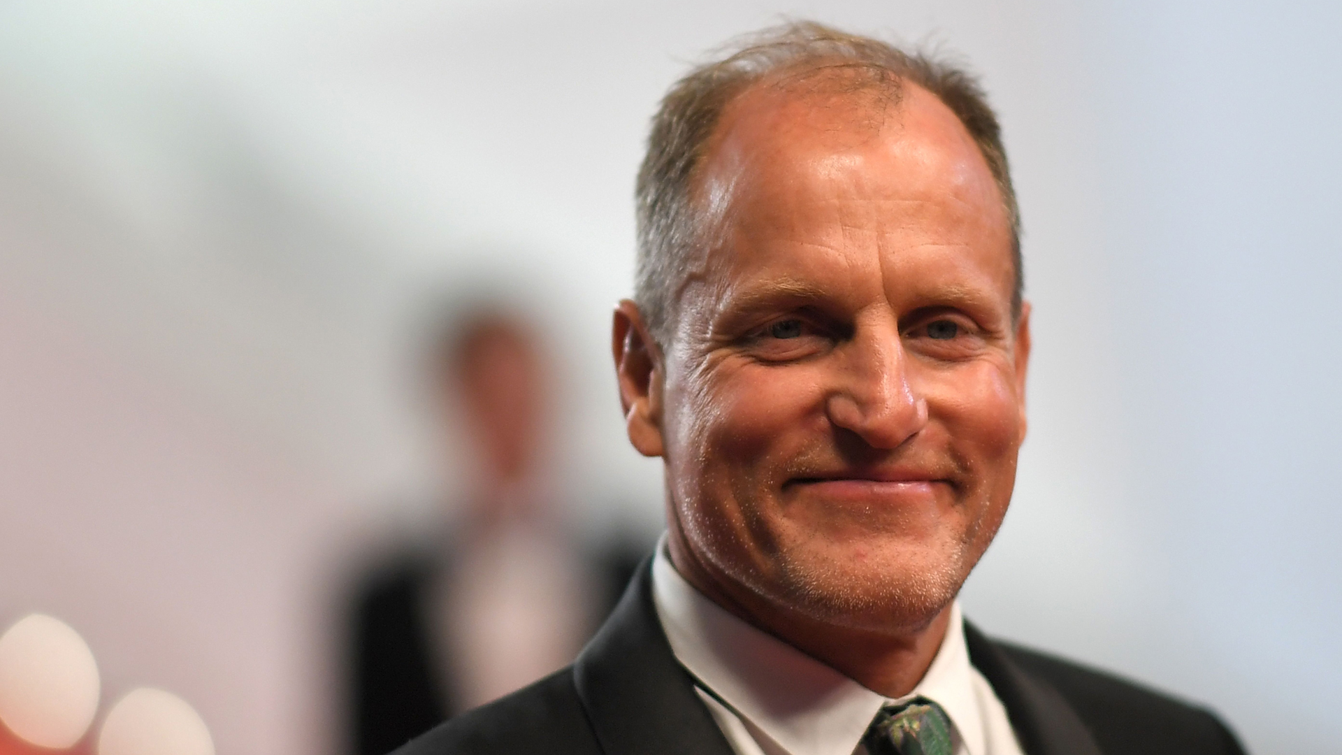 Actor Woody Harrelson poses as he leaves the Festival Palace on May 15, 2018. (Credit: LOIC VENANCE/AFP/Getty Images)