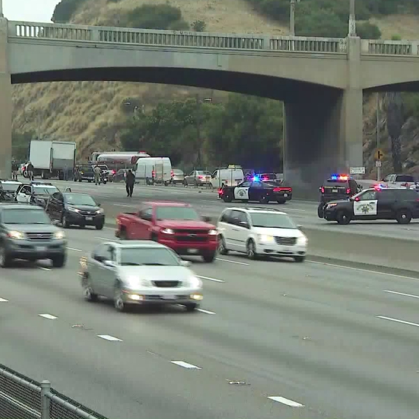 Officers respond to a crash on the 101 Freeway through the Cahuenga Pass on June 19, 2019. (Credit: KTLA)
