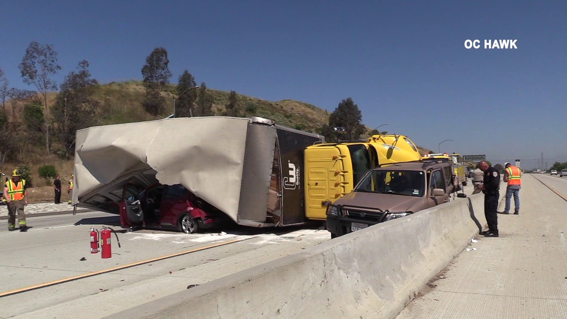 A box truck overturned, pinning a car beneath it, after being involved in a multivehicle crash in Chino Hills on June 12, 2019. (Credit: OC Hawk)