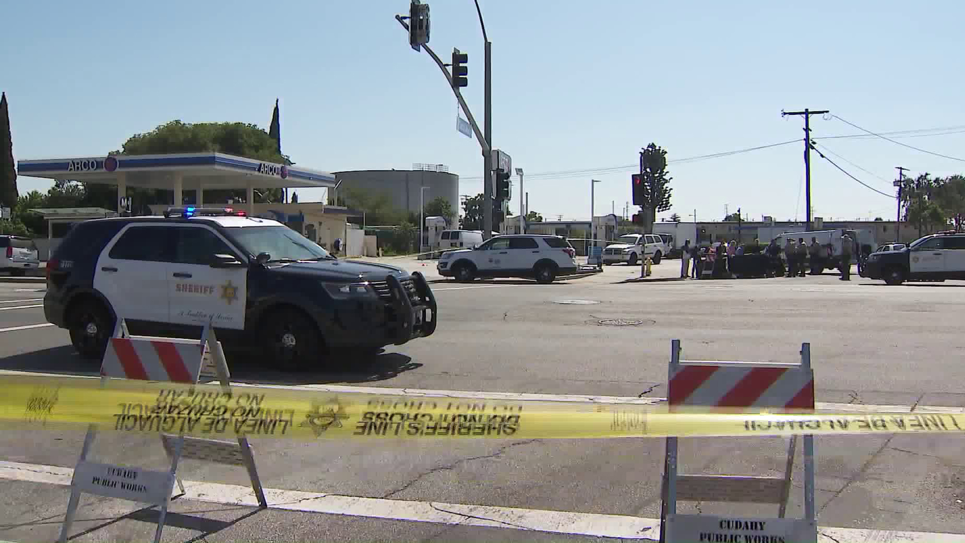 Los Angeles County Sheriff's officials remain at the scene of a fatal shooting in Cudahy on June 19, 2019. (Credit: KTLA)