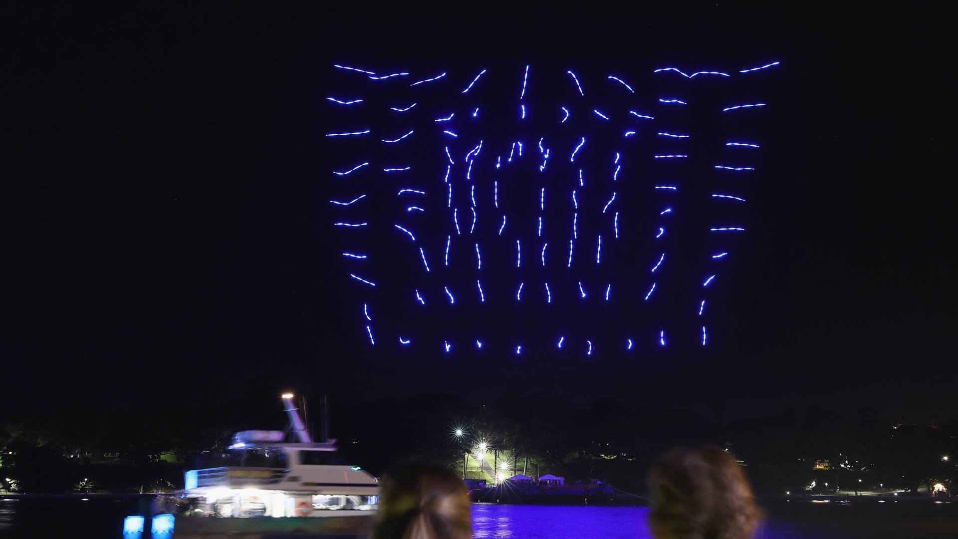 A hundred illuminated drones perform a choreographed routine over Sydney Harbour on June 8, 2016 in Sydney, Australia. (Credit: Cameron Spencer/Getty Images)