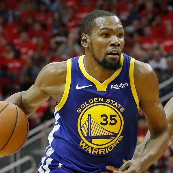 Kevin Durant #35 of the Golden State Warriors drives to the basket defended by James Harden #13 of the Houston Rockets in the second half during Game Three of the Second Round of the 2019 NBA Western Conference Playoffs at Toyota Center on May 4, 2019, in Houston, Texas. (Credit: Tim Warner/Getty Images)