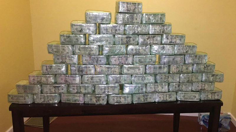 An undated photo shows some of the $6 million dollars seized as part of an investigation into money laundering that resulted in forty defendants charged in San Diego with conspiring to launder millions of dollars in drug money for Mexican Cartels. (Credit: FBI via Los Angeles Times)