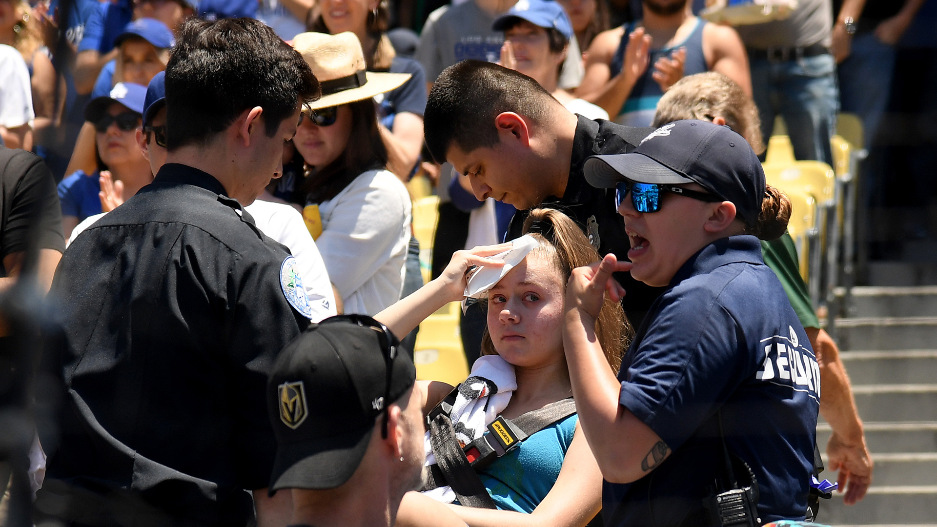 Kaitlyn Salazar, 13, puts an ice pack to her head after she was hit by a foul ball off the bat of Cody Bellinger #35 of the Los Angeles Dodgers during the first inning against the Colorado Rockies at Dodger Stadium on June 23, 2019 in Los Angeles, California. (Credit: Harry How/Getty Images)
