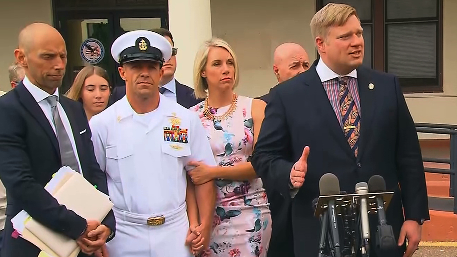 Navy Special Operations Chief Edward Gallagher, second from left, stands alongside his wife as his attorney Timothy Parlatore addresses the media following day three of the SEAL's war crimes trial in San Diego on June 20, 2019. (Credit: CNN)