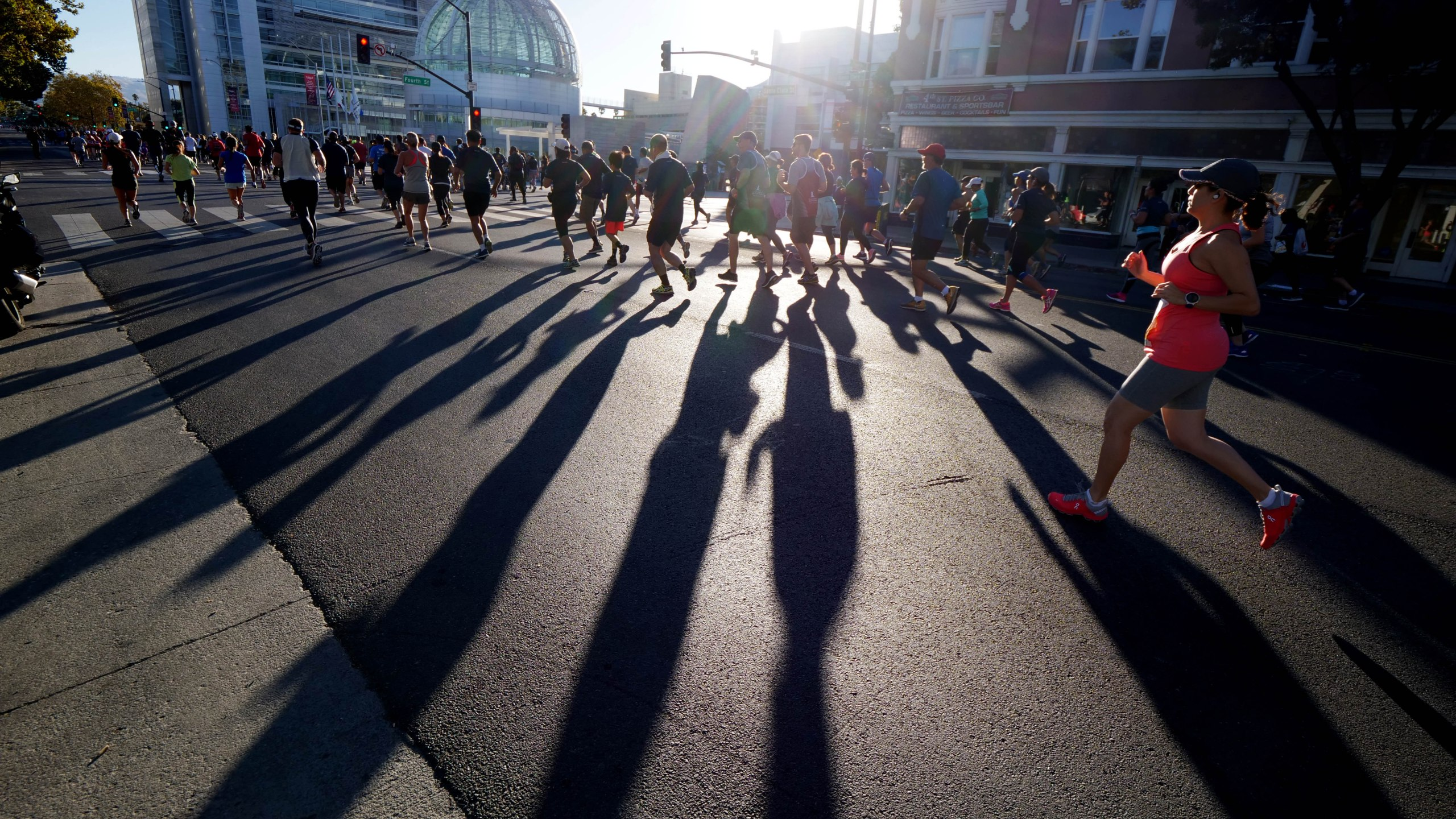 Runners approach City Hall during the Michelob Ultra Rock 'n' Roll San Jose 1/2 Marathon and 10K on Oct. 7, 2018 in San Jose, California. (Credit: Donald Miralle/Getty Images of Rock 'n' Roll)