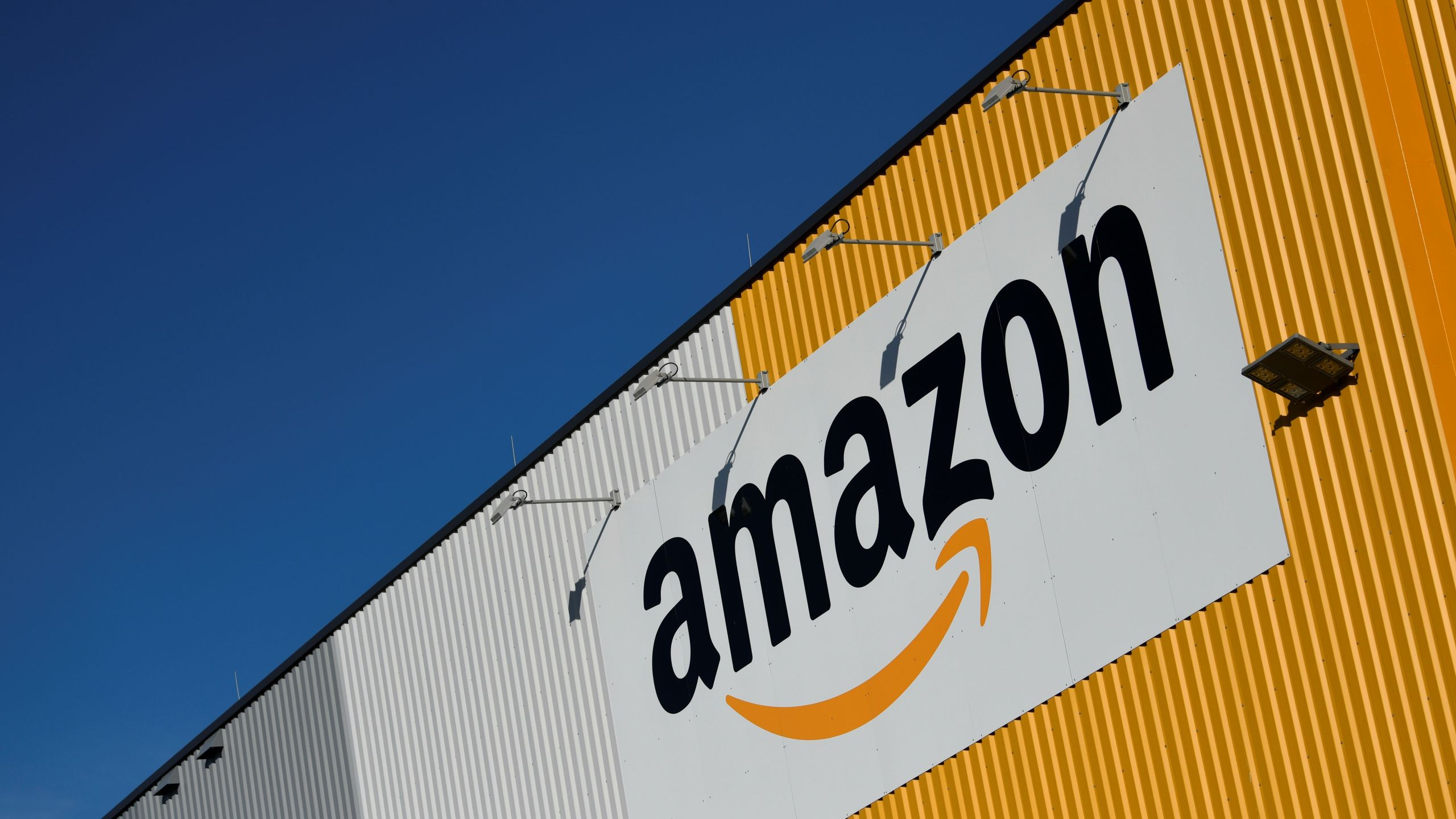 A picture taken on Nov. 8, 2018 shows the Amazon logo displayed outside the group's distribution center in Dortmund, Germany. (Credit: INA FASSBENDER/AFP/Getty Images)