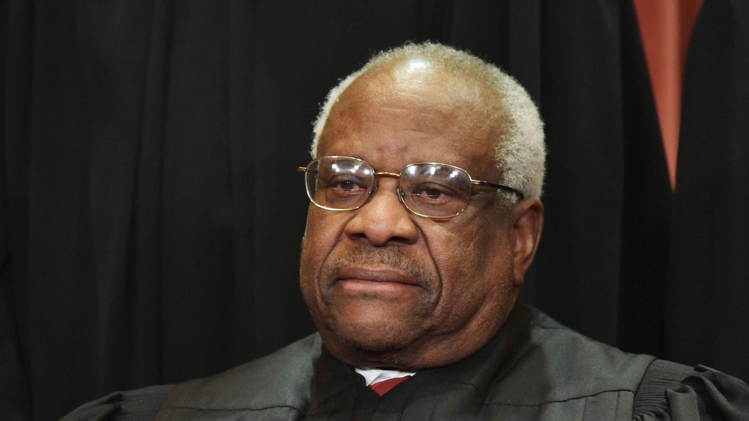 Justice Clarence Thomas poses for the official group photo at the Supreme Court in Washington, DC on November 30, 2018. (Credit: MANDEL NGAN/AFP/Getty Images)